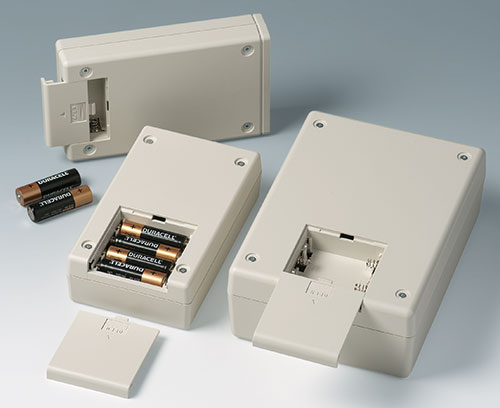 Battery compartments for AA and 9 V cells